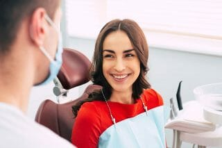 Woman smiling at dental hygienist