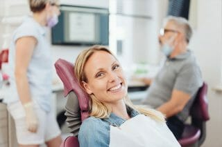 Woman smiling in dental exam room
